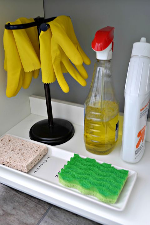 Towel holder for hanging rubber gloves and labeling a tray to keep from mixing up sponges | IHeart Organizing: Reader Space: A Brilliantly Organized Bath
