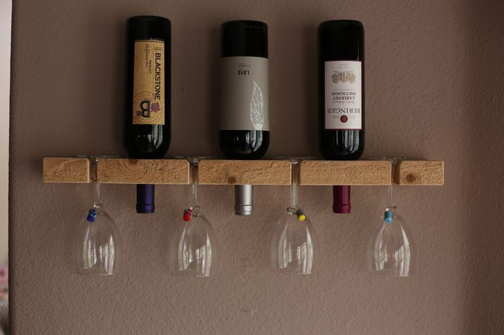 "Wooden wall-mount wine rack made of one solid piece of pine, carefully hand crafted in the USA. - Horizontal wine rack holds 3 bottles of wine and 4 glasses safely. - Size: 24"" wide, 3 1/2"" high and 1 1/2"" deep. Created with a rustic, modern and refined charm. https://www.etsy.com/listing/186222924/wall-wine-rack-handmade-rustic-3-bottle?"