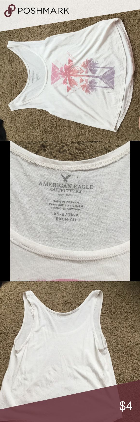 American Eagle Summer Palm Tree Tank Top * What you are viewing is a pre-owned women's size XS American Eagle Tank Top.   *Beautiful pink, orange (salmon), and purple design on the front.   *Light-weight and perfect for spring/summer.   *While it is pre-owned, it has only been worn 2-3 times and looks and feels just like new.   *Would go great with the black American Eagle super-stretch shorts that I also have for sale! American Eagle Outfitters Tops Tank Tops