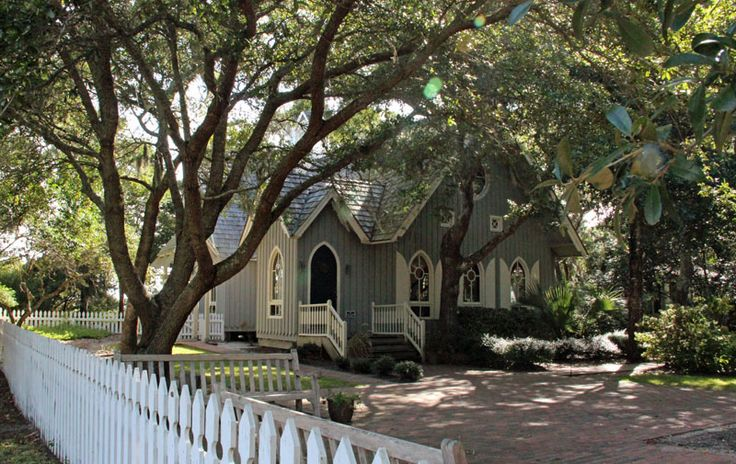 The quaint Bald Head Island Chapel is situated near the lighthouse, and overlooks Bald Head Creek.