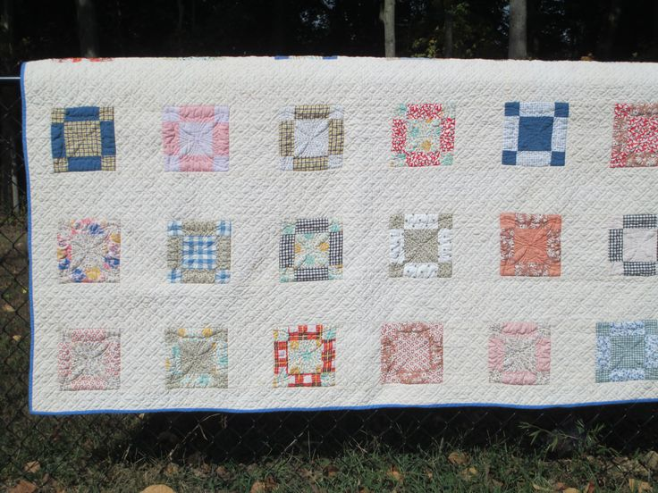 Here is a vintage top, pieced by a friend's mom a long time ago.  I just finished the actual quilting.