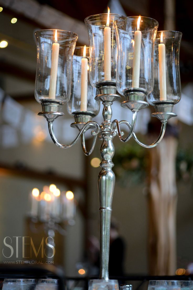 Silver candelabras can be used as a more budget friendly