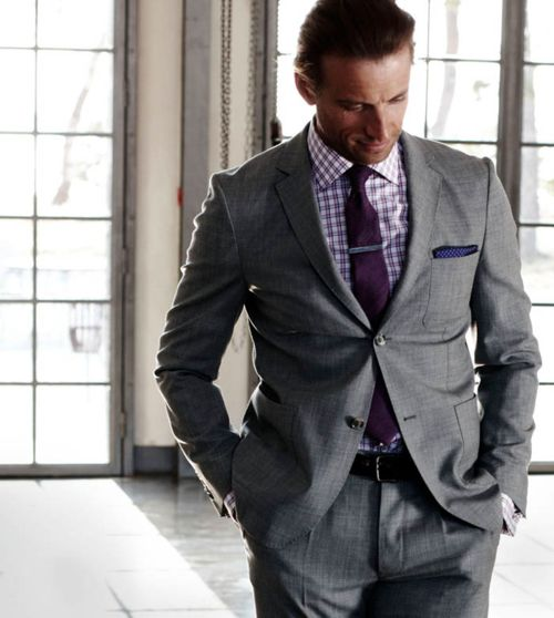 Medium grey suit with purple accesories.