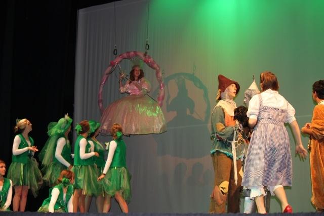 Glinda flies in!