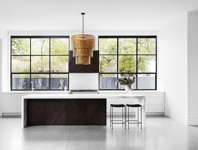 A sleek galley kitchen with clean lines is flanked by two steel windows overlooking the garden in this restored Edwardian home. Photography: Sean Fennessy   Styling: Heather Nette King