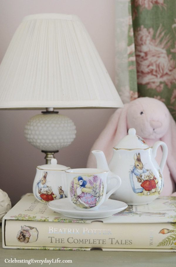 A Little Girl's Pink & Green Bedroom from Celebrating Everyday Life (celebratingeverydaylife.com), white crib, white lace canopy, pink & green toile drapes, angel wings, white dresser, peter rabbit, beatrix potter tea set, peter rabbit themed nursery, pink and green nursery