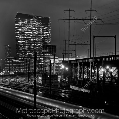 Black and White Picture of A Train Pulling into the Philadelphia 30th Street Station in Philadelphia. Framed, and Ready-to-Hang in a variety of frame styles and sizes.