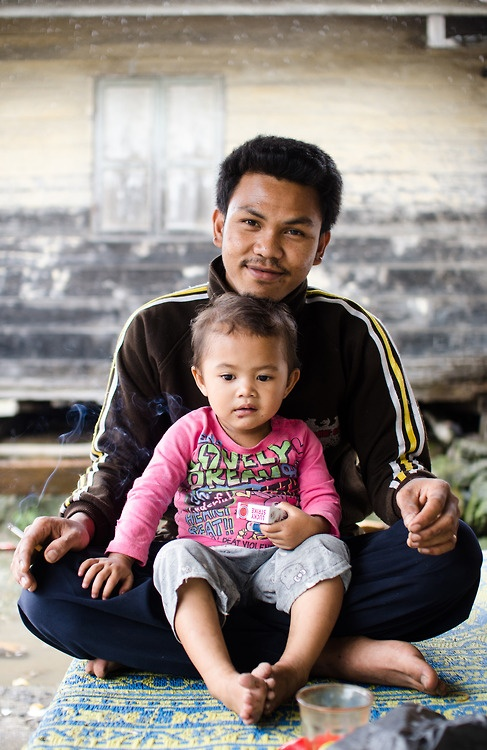 The Batak Karo people Northern Sumatra's Berastagi region are incredibly community oriented. A man tried to hold his cigarette just out of reach of a friend's child while posing for a portrait.