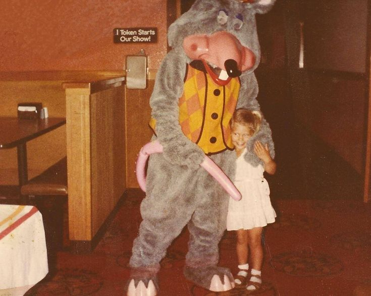 """Family fun at Chuck E. Cheese's for my birthday.  As a parent myself, I find this photo highly disturbing, and causes me to question my entire childhood.  I mean, what kind of parent allows their daughter to wear socks with sandals?!"" (submitted by Angela)"