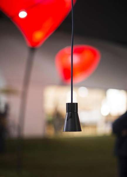 catenaria di luce serpentine   Viabizzuno   IP44 suspension light fitting for outdoor. realized with a 25mt long electric wire, on which con be applied, to the desired distance, 3000K 4W 24Vdc led light sources or 25W 24Vca light bulbs. led light sources are available in different models: with sandblasted glass for a diffused light, with adjustable spotlight or fixed spotlight for accent light, power supply max100W not included. it is also possible to use 24V light bulbs for diffused light