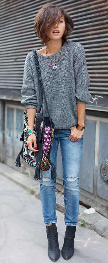 Zoe Jonak is wearing grey knit from American Apparel, ripped jeans from Zara, bag from Antik Batik and the boots are from Acne