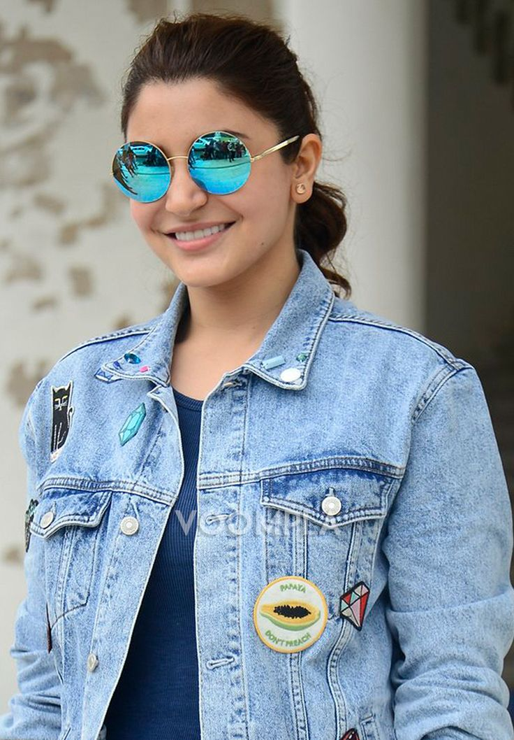 Swag! Anushka Sharma styles up in glossy blue round sunglasses & a denim jacket. via Voompla.com