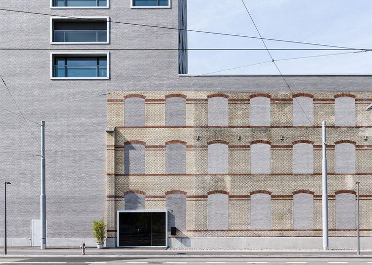 Zurich building by E2A incorporates facade of old warehouse