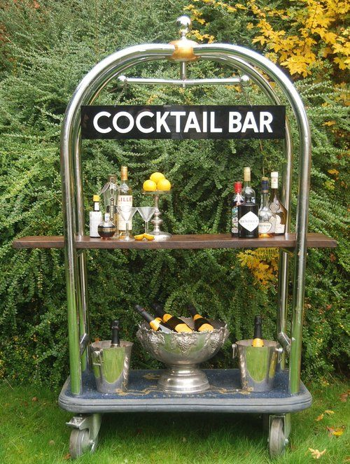 Ritz Trolley Luggage Cocktail Bar Set - includes: Ritz luggage trolley, 1950s cocktail bar sign, two copper champagne buckets, one champagne bowl, wire bottle holder and cocktail shaker - £100    http://www.loveslanevintagehire.com/