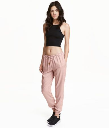 Powder pink. Pants in soft, woven viscose with an elasticized drawstring waistband. Side pockets and wide, gently tapered legs with elasticized hems.