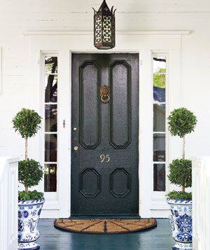 The Hillman Group Traditional house numbers in brass     Paint for front door: Benjamin Moore Impervex Metal & Wood Enamel in black (similar to shown), $60 a gallon, benjaminmoore.com for stores.