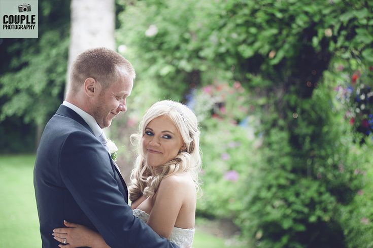 The happy couple in the colourful gardens at Rathsallagh. Weddings at Rathsallagh House Hotel by Couple Photography.