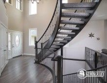 Open to above foyer with open riser, curved staircase. Onyx floorplan as built in Keswick n the River, by Kimberley Homes, Edmonton.  #interiordesign #newhomedesign #homedesign #newhome #customhome #yegre #buildwithkimberley #kimberleyhomes