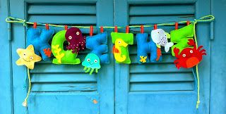 Felt banner with a boy's name in blue and green. The under the sea creatures are super cute!