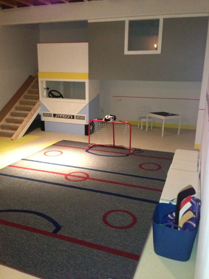 Made a hockey playroom for a little boy. Treehouse, slide, airbrushed carpet, blackboard paint on wall.