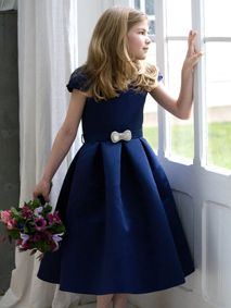 This dress is called Ruthie and is1950s inspired with a bow shaped pearl and bead buckle on a belt. Made in a sumptuous satin. Available in other colours.