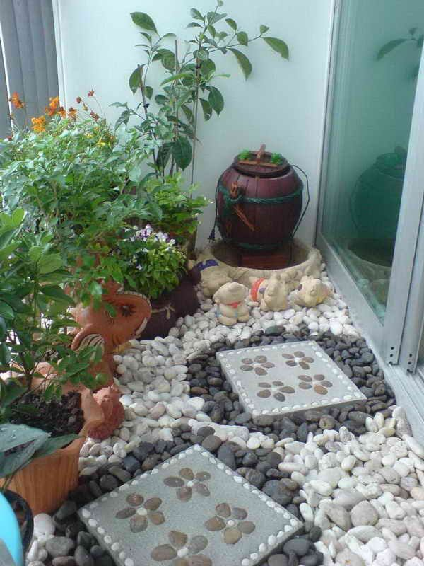 Use rocks and pavers, just like you would in a yard, to add architectural interest to your apartment balcony garden.