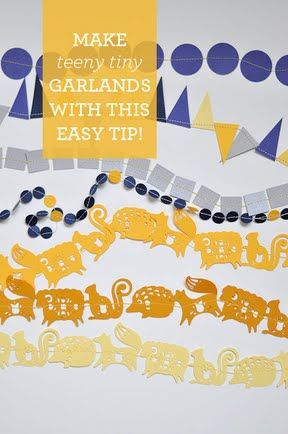 DIY: Make tiny paper garlands with this easy method! Use washi tape to hold pieces in place, while feeding through sewing machine.