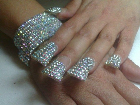 Dazzling and sparkling french nail tips with clear rhinestones at the tip of each nail...Bling Bling to the prom