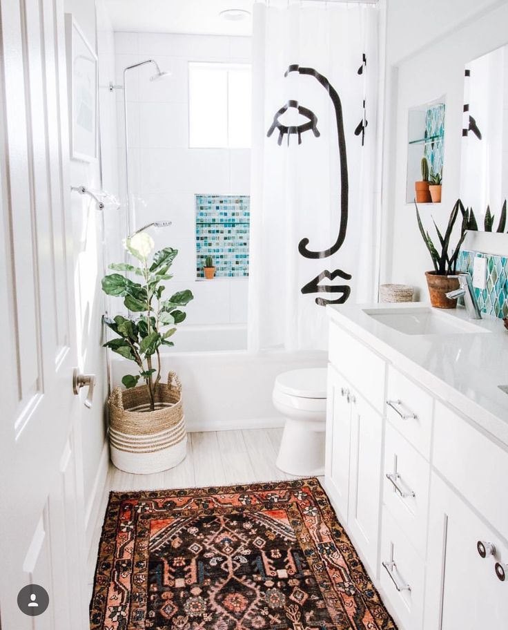 Face shower curtain // white and boho bathroom with pops of teal tile