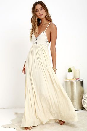 This isn't just your ordinary festival fare, the Hippie Hippie Chic Cream Maxi Dress takes Boho to a whole other level! A crocheted bodice takes inspiration from flower child fashion, updated by a woven cream skirt that falls gracefully towards the floor. Adjustable spaghetti straps crisscross at back. Hidden back zipper/hook clasp.