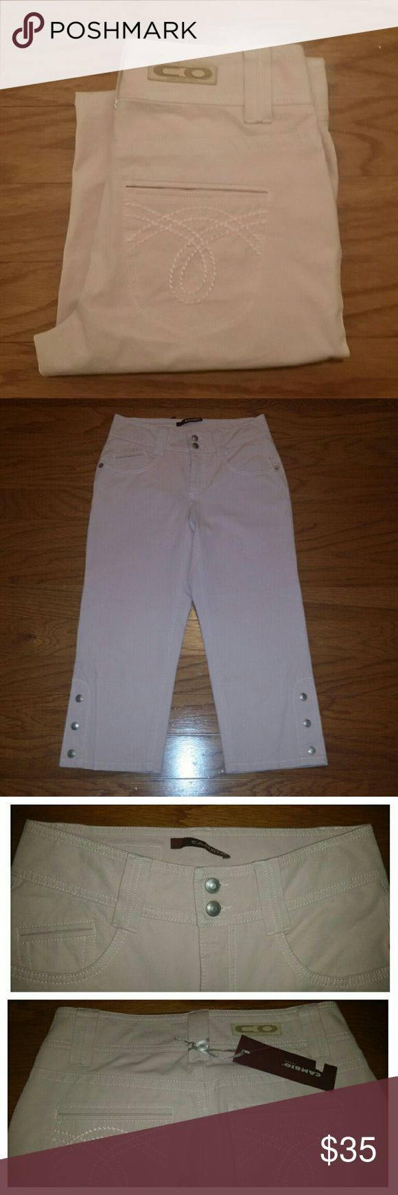 """Cambio Jeans  (Capri) These jeans are a pale pink color.  The size on the the tag says 36 but the measurements are: waist laying flat 14"""", 22"""" inseam, 9"""" front rise and 15"""" back rise. These are new, never worn. While taking pictures noticed what looks like a small ink spot at the very bottom of the pants (pictured). Cambio Pants Capris"""