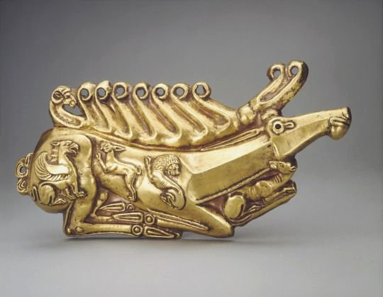 Scythian Gold Stag Plaque, 5th Century BC  Found in the Kul Oba Barrow near Kerch, Crimea. Decorated with a griffin, rabbit, lion, panther and a ram.  The Scythians had reverence for the stag, which was one of the most common motifs in their artwork, especially at funeral sites. The swift animal was believed to speed the spirits of the dead on their way to the afterlife.