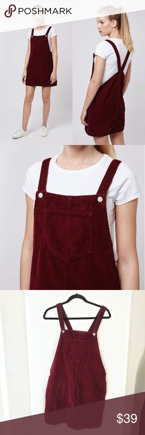 """Topshop TALL MOTO Cord Pinafore Dress Opt for an alternative to denim with this MOTO cord pinafore dress. In a clean, textured finish, there's a distinctive '70s edge to this throw-on style. Comes with practical patch pockets and button shoulder fastenings.  Condition: new without tag Size: 8 Bust flat 18.25"""" Length 33""""   100% Cotton. Machine wash.  Colour:BURGUNDY Topshop Dresses Mini"""
