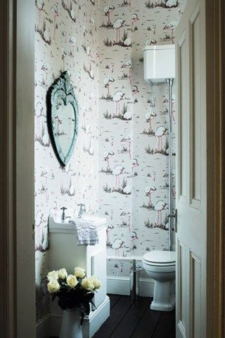Create a fanciful retreat in your bathroom by papering all four walls in a dynamic print. The continuous pattern allows your eye to roam the room rather than be confronted by a solid colour.