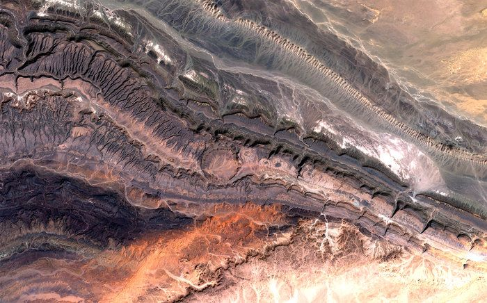 Part of the Anti-Atlas mountains bordering the Sahara Desert in western Algeria is pictured in this satellite image.The Anti-Atlas range was born from continental collision, and geologists believe it was once higher than the Himalayas, but was reduced through erosion.Here the land is most…