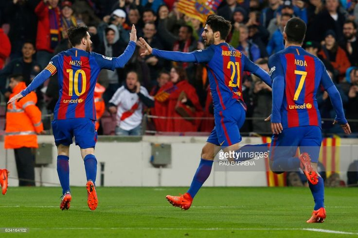 Barcelona's Argentinian forward Lionel Messi (L) and Barcelona's Portuguese midfielder Andre Gomes celebrate after Barcelona scored the opener during the Spanish Copa del Rey (King's Cup) semi final second leg football match FC Barcelona vs Club Atletico de Madrid at the Camp Nou stadium in Barcelona on February 7, 2017. / AFP / PAU