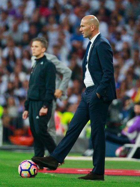 Zinedine Zidane head coach of Real Madrid controls the ball during the La Liga match between Real Madrid CF and FC Barcelona at Estadio Bernabeu on April 23, 2017 in Madrid, Spain.