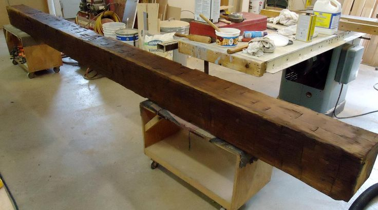 Hand hewn cherry barn beam to be used for a mantle -- Robert Kane Custom Woodworking