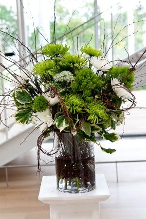 green branch arrangement...something different and might be cheaper than flowers