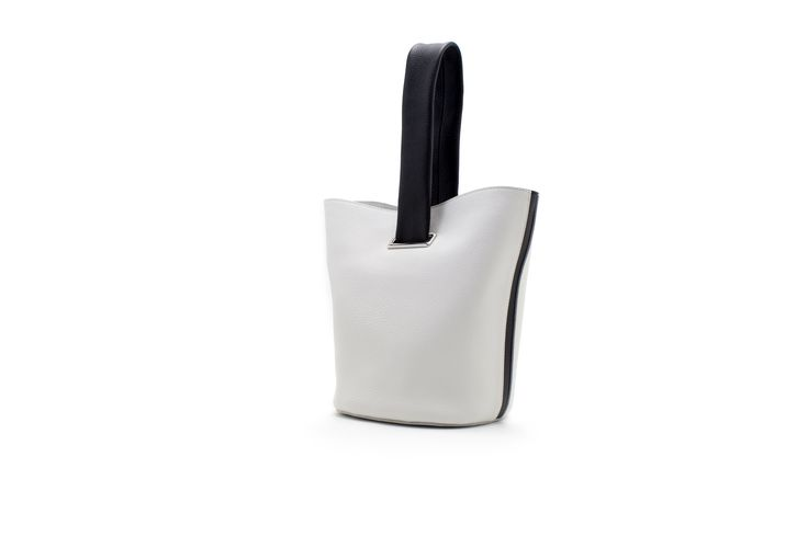 A leather white wrist bag with black handle by NAGATANI