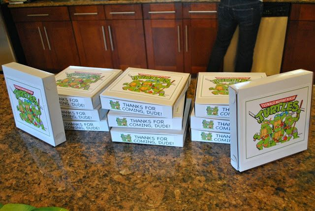 """Our """"goodie bags"""" went home in the form of pizza boxes. I just found those pictures online, printed them on full page label paper, and stuck it right on the pizza box. It was pretty simple and turned out really cute"""