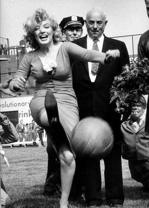 Marilyn Monroe kicks a ball at Ebbets Field, New York, May 1957.