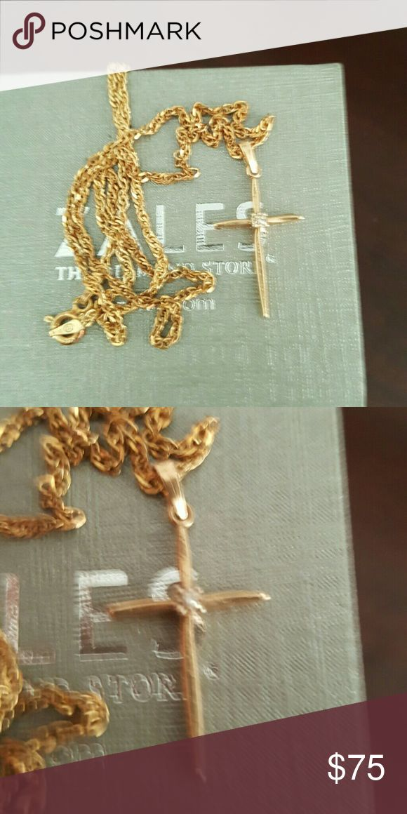 14k gold cross with 24k gold chain 14k gold cross with diamond accent with a 24k gold chain. Obviously not original chain but this one is much nicer than the flimsy one that came with this cross. Zales Jewelry Necklaces