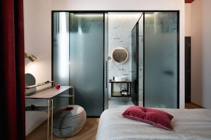 Interni Magazine - Nella città simbolo del design, apre un'eleganteConti Guest Housedallo stile urban chic. Per il progetto di restauro, progettazione ed interior design è