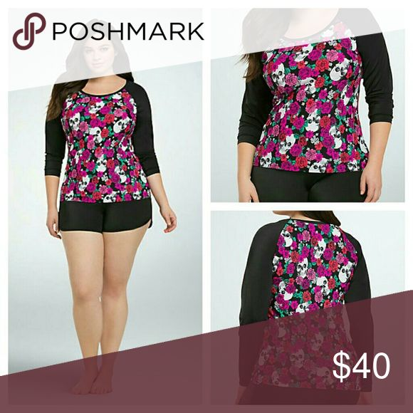 ON HOLD Torrid Floral Skull Rash Guard 0x swim top Top only  This rash guard is perfect for beating the sun! The multi-color floral and skull print body pairs beautifully with the sporty black sleeves. Constructed with swim material so you can lounge without getting burned and swim without worrying about coverage.  Nylon/spandex Hand wash cold, line dry Imported plus size rash guard torrid Swim