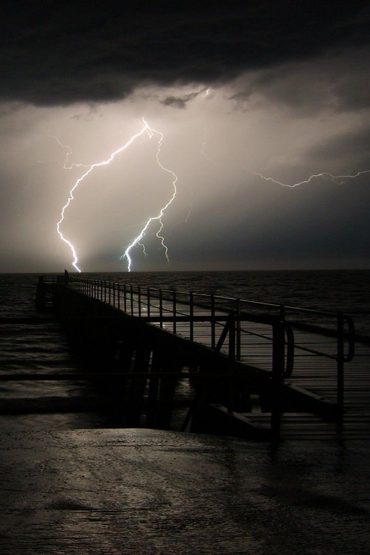 """stormy sky and a pier: I asked, """"does this mean something; that the pier is short?"""" The dream character answered, """" I don't think so""""."""