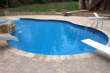 Inground Pools With Diving Board And Slide a picture of a freedom lake left inground swimming pool with
