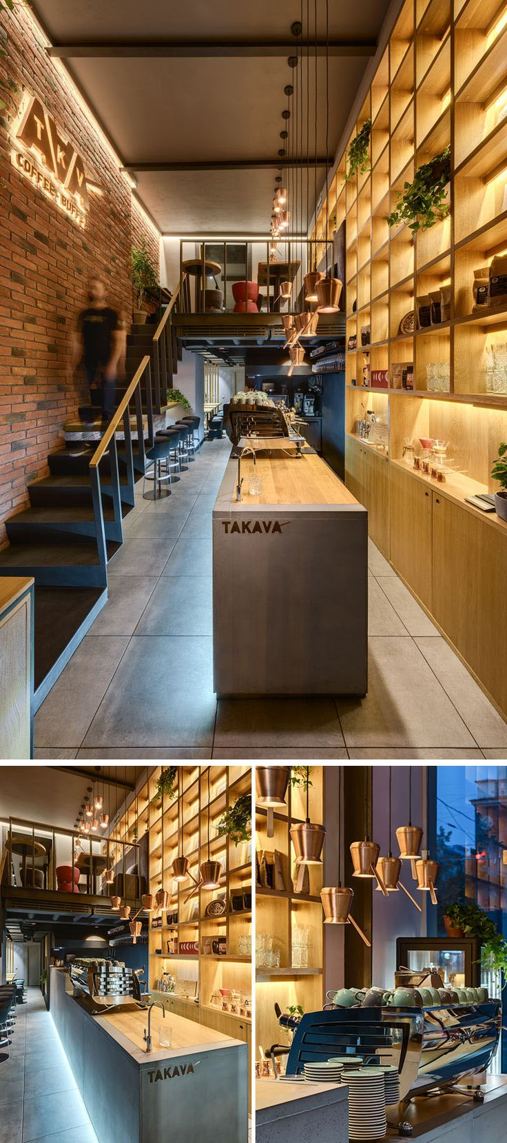 Stepping inside this modern coffee shop, there's a wall of shelving behind the bar that draws the eye upward to show off the height of the space. A long concrete and wood bar has custom pendant lights made from coffee pots. #ModernCoffeeShop #ModernCafe
