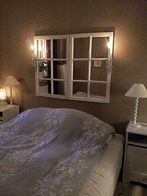 love the old window frames as a headboard