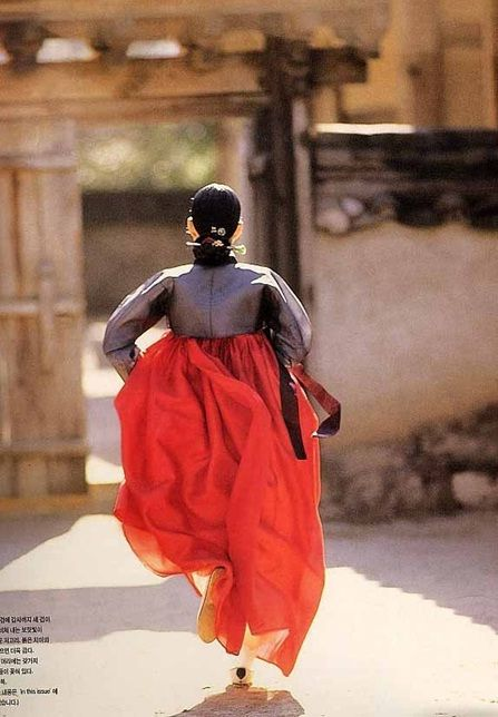 This would've been so me couple of centuries ago. Girl running in a hanbok.